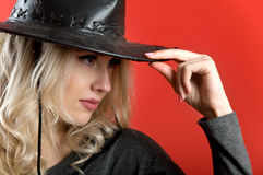 Sexy blonde with curly hair wearing a cowboy hat Royalty Free Stock Photos