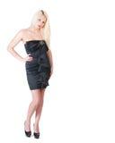 Sexy blonde Dame im schwarzen Kleid gegen Weiß Stockfotos