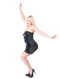 Sexy blonde Dame im schwarzen Kleid gegen Weiß Lizenzfreies Stockbild