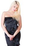 Sexy blonde Dame im schwarzen Kleid gegen Weiß Stockfotografie