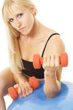 Sexy blonde with dumbbells Royalty Free Stock Image