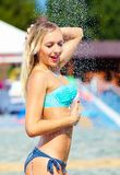 Sexy blonde enjoying summer shower Stock Image