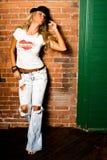blonde fashion model against brick Royalty Free Stock Image