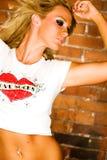 Sexy blonde fashion model against brick Stock Photo