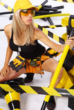Sexy blonde female worker Stock Photos