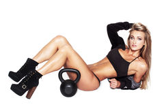 Sexy blonde fitness model with kettlebell Royalty Free Stock Photography