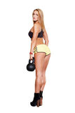 Sexy blonde fitness model with kettlebell Royalty Free Stock Photos