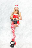 Sexy blonde fitness model with kettlebell in snowflakes Stock Photos