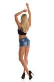 Sexy blonde Frau, die hintere Ansicht aufwirft Stockbild