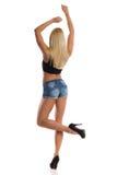 Sexy blonde Frau, die hintere Ansicht tanzt Stockfoto