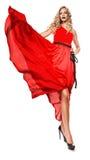 Sexy blonde Frau im langen roten Kleid Lizenzfreies Stockfoto