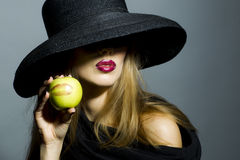 Sexy blonde girl with apple Stock Photography