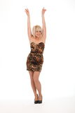 Sexy blonde girl arms raised in short dress Royalty Free Stock Images