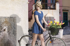 blonde girl with bicycle Royalty Free Stock Photography