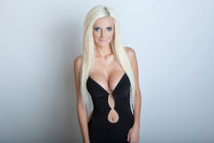 Sexy blonde girl in black clothes Stock Image