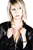 Sexy Blonde Girl with Black Leather Jacket Royalty Free Stock Photography