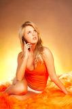 Sexy Blonde girl with cell pho Stock Photography