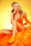 Sexy Blonde girl with cell phone Royalty Free Stock Photography