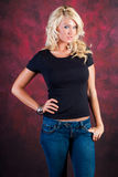 Sexy blonde girl fashion model in blue jeans Stock Image