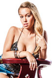 Sexy blonde girl / fashion model. Sexy blonde woman in trendy fashion clothing. Fashion model girl showing cleavage / breasts Royalty Free Stock Images