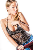 Blonde girl / fashion model. Blonde woman in trendy fashion clothing. Fashion model girl showing cleavage / breasts stock image