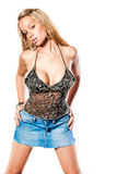 Sexy blonde girl / fashion model. Sexy blonde woman in trendy fashion clothing. Fashion model girl showing cleavage / breasts. Blue denim short mini skirt Stock Images