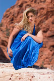 blonde girl in fashionable dress stock images