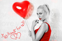 blonde girl with heart ballon in black and white. royalty free stock photography