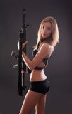 Sexy blonde girl holding rifle Royalty Free Stock Images