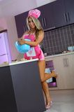 Sexy blonde girl in kitchen Stock Images