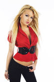 Sexy blonde girl in red blouse with black belt on white background Royalty Free Stock Photography