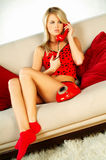 Blonde girl with red phone. Close up royalty free stock photo