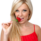 Sexy blonde girl with strawberries Royalty Free Stock Photo
