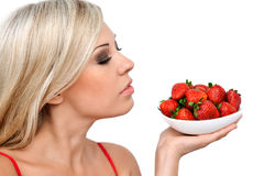 Sexy blonde girl with strawberries Stock Image
