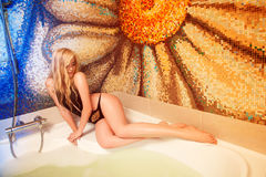Sexy blonde girl taking bath Stock Photography