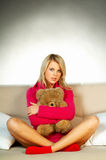Sexy blonde girl with teddy bear Stock Photo