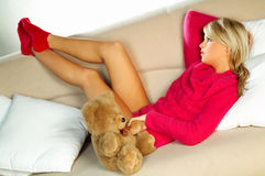Sexy blonde girl with teddy bear Stock Photography