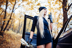 Sexy blonde girl with weapon Royalty Free Stock Photos