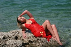 Sexy blonde girl with wet dress. Sexy blonde girl with wet red dress Royalty Free Stock Photos