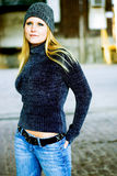 Sexy Blonde Girl in Winter Sweater & Hat Royalty Free Stock Photography