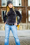 Sexy Blonde Girl in Winter Sweater & Hat Royalty Free Stock Photo