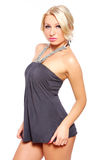 Sexy blonde in gray dress Royalty Free Stock Images