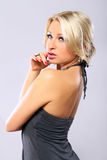 Sexy blonde in gray dress Royalty Free Stock Photos