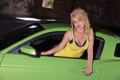 Sexy blonde in green car Royalty Free Stock Images
