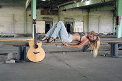 Sexy Blonde with a Guitar (3) Royalty Free Stock Image
