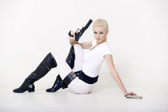Sexy blonde with a gun Royalty Free Stock Images