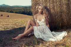 Sexy blonde in hayfield Stock Images
