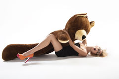 Sexy blonde with huge teddybear Royalty Free Stock Photography