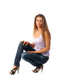 Sexy blonde in jeans Stock Images
