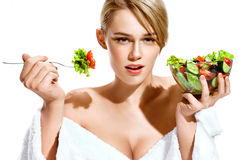 blonde lady eating healthy food. stock photo